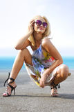 Happy blonde on coast Stock Photography
