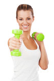 Happy blonde female exercising with weights Royalty Free Stock Photos