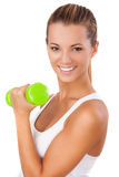 Happy blonde female exercising with weights Stock Photos