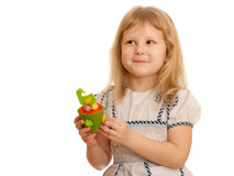 Happy blonde girl holding easter hen Stock Photo