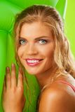 Happy blonde girl with mattress Stock Image