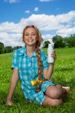 Happy blonde girl with milkshake Stock Images