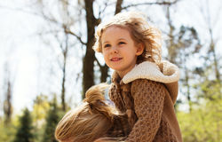 Happy blonde girl outdoor Royalty Free Stock Photos