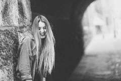 Happy blonde girl smiling in urban background Royalty Free Stock Image