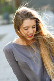 Happy blonde girl in urban background Royalty Free Stock Photography
