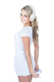 Happy blonde girl in winter headphones with gift Royalty Free Stock Image