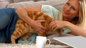 Happy blonde with her cat stock video