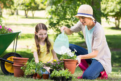 Happy blonde and her daughter gardening Stock Photo