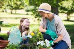 Happy blonde and her daughter gardening Stock Photos
