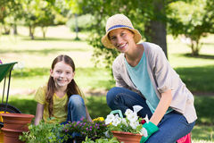 Happy blonde and her daughter gardening Stock Image