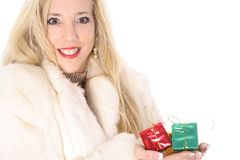 Happy blonde holding presents Royalty Free Stock Images