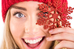 Happy blonde holding red snowflake Stock Photo