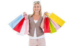Happy blonde holding shopping bags Royalty Free Stock Photo
