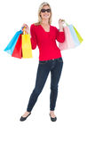 Happy blonde holding shopping bags Stock Photography