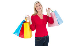Happy blonde holding shopping bags Stock Images