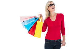 Happy blonde holding shopping bags Royalty Free Stock Images