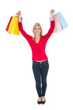 Happy blonde holding shopping bags Stock Photo
