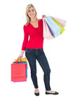 Happy blonde holding shopping bags Stock Photos