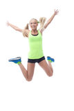 Happy blonde jumping in studio, isolated on white royalty free stock photography