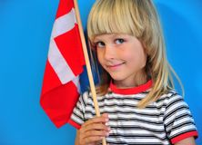 Happy blonde kid with a flag of Denmark stock photo