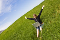 Happy blonde with laptop Royalty Free Stock Images