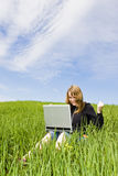 Happy blonde with laptop stock image