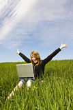 Happy blonde with laptop stock images