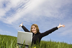 Happy blonde with laptop royalty free stock photography