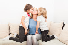 Happy blonde mother with young daughters Stock Photography