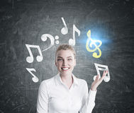 Happy blonde music teacher Royalty Free Stock Photos