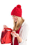 Happy blonde opening gift bag Stock Photography