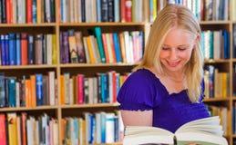 Happy blonde reader stock photo