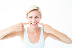 Happy blonde smiling showing her tooth Stock Photo