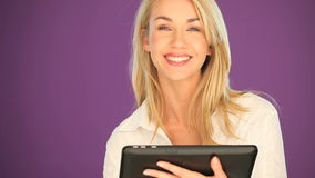 Happy blonde student working on a tablet stock video