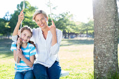 Happy blonde swing with her daughter Stock Image