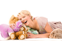Happy blonde with toys. Happy blonde with a lot of toys Stock Photo