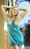 Happy blonde in turquoise dress Royalty Free Stock Image