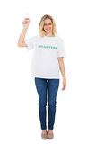 Happy blonde volunteer holding light bulb Royalty Free Stock Image