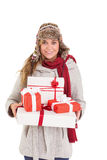 Happy blonde in winter clothes holding gifts Stock Images