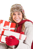 Happy blonde in winter clothes holding gifts Stock Image
