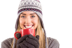 Happy blonde in winter clothes holding mug Stock Photography