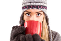 Happy blonde in winter clothes holding mug Stock Photo