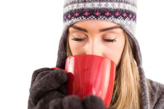 Happy blonde in winter clothes holding mug Stock Photos