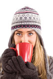 Happy blonde in winter clothes holding mug Stock Images