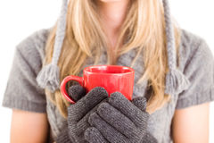 Happy blonde in winter clothes holding mug Royalty Free Stock Photo