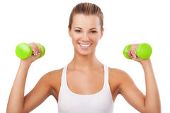 Happy blonde woman exercising with weights Royalty Free Stock Images