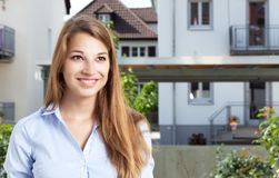 Happy blonde woman in front of her new flat Stock Photography