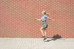 Happy blonde woman goofing around Royalty Free Stock Images