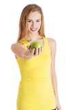 Happy blonde woman holding an apple Stock Images