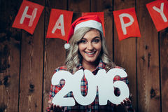 Happy blonde woman holding 2016 numbers Stock Photography